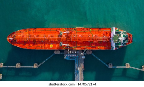 Aerial view tanker ship vessel unloading at port, Business import export oil and gas petrochemical with tanker ship transportation oil from dock refinery, Loading arm oil and gas offshore platforms. - Shutterstock ID 1470572174