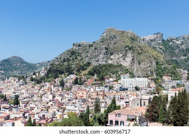 Aerial view of Taormina, historic city at the Sicilian coast of Italy with castelmola at the top of the rock