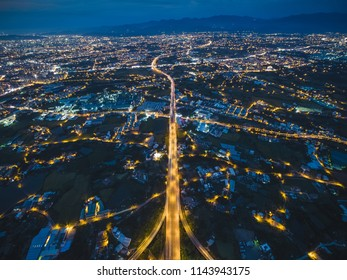 Aerial View of Taoyuan City - City, Transport, High altitude nightscape concept image. Long exposure birds eye view use the drone, shot in Taoyuan, Taiwan.