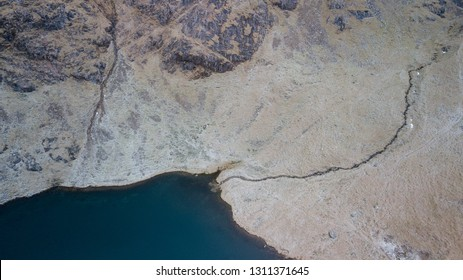 Aerial view of a tarn on the Old Man of Coniston, Lake District, UK