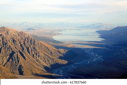 Aerial View of Tasman Glacier River to Lake Pukaki from Helicopter Mount Cook National Park New Zealand