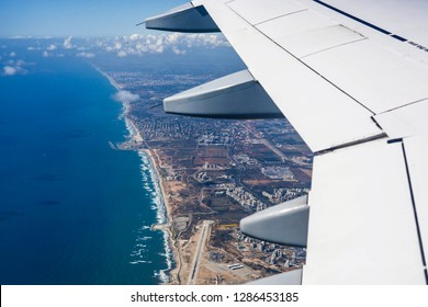 Aerial view of Tel Aviv City northern shore above Mediterranean Sea at the Middle East. Bright Israel view from window seat in vacation economy flight - Image