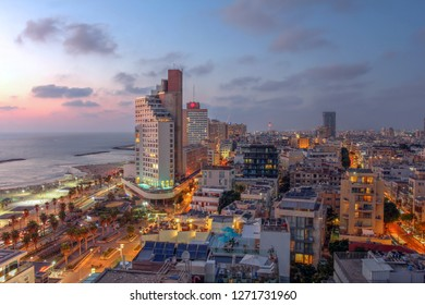 Aerial view of Tel Aviv skyline Israel at sunset with the beachfront promenade as viewed from Isrotel Tower facing north.