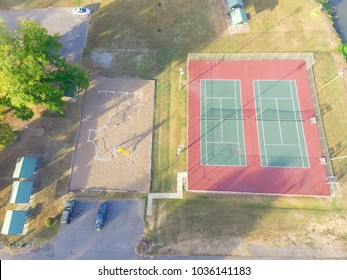 Aerial view tennis court at public park in Ozark, Arkansas, America at sunset. Top view outdoor court with backdrop, divider nets.