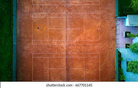 Aerial view of the tennis court. Unrecognizable people play tennis