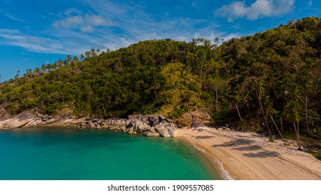 Aerial view of the Thailand coastline, boulders and white sand beach