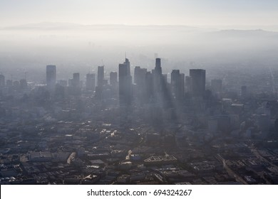 Aerial view of thick summer smog in urban downtown Los Angeles, California.