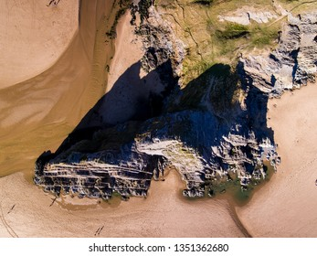 Aerial view of Three Cliffs Bay south coast beach the Gower Peninsula Swansea Wales uk