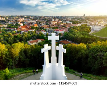 Aerial view of the Three Crosses monument overlooking Vilnius Old Town on sunset. Vilnius landscape from the Hill of Three Crosses, located in Kalnai Park, Lithuania.