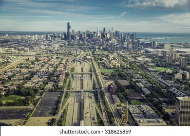 Aerial view through Chicago Downtown with highway and railroad