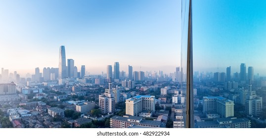 aerial view of tianjin cityscape in the morning with reflection on glass curtain wall
