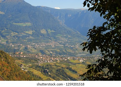 "Aerial view of Tirol (German: ""Dorf Tirol"") nearby Meran, South Tyrol, Italy. Tirol  is a comune (municipality) located about 25 km (16 mi) northwest of the city of Bolzano"