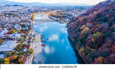 Aerial view Togetsukyo bridge and boats in katsura river, Arashiyama, Kyoto , Japan.