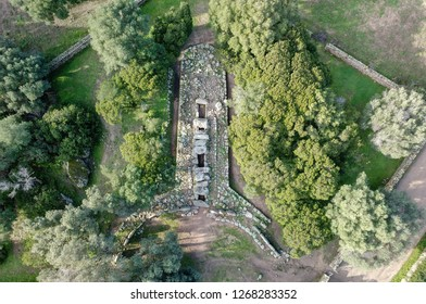 "Aerial view of the Tomb of giants ""Su Mont'e s'abe"", Olbia, one of the many ancient and mysterious archaeological sites of the beautiful island of Sardinia"