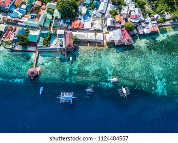Aerial view or Top view of bay and shore in Oslob, Cebu, Philippine. It is a best place to snorkel and scuba drive. There is a deep clean blue ocean and has many local Filipino boats in the sea.