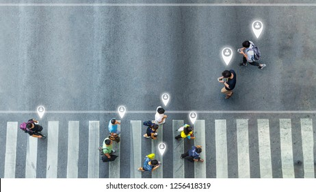 Aerial view and top view with blur man with smartphone walking converse with busy city crowd move to pedestrian crosswalk. concept art of person icon connecting.