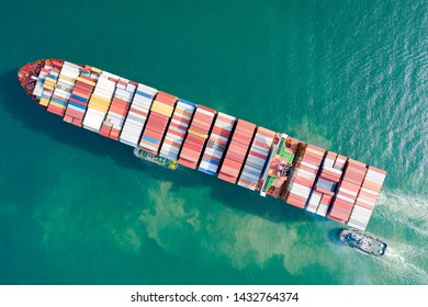 Aerial view and top view. Container ship in pier with crane bridge carries out export  and import business in the open sea. Logistics and transportation