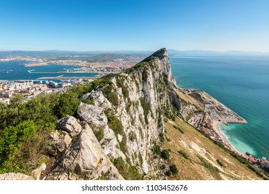 Aerial view of top of Gibraltar Rock, in Upper Rock Natural Reserve: on the left Gibraltar town and bay, Mediterranean Sea on the right, United Kingdom, Europe