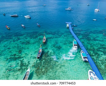 Aerial view or top view of tropical island beach with clear water at Coral Island, Koh Hey, Phuket, Thailand