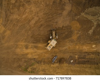 aerial view - top view of a wheel loader bulldozer on construction site