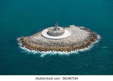Aerial view of The Torre do Bugio Lighthouse. It is a fortified light house that stands in the centre of the Tejo estuary