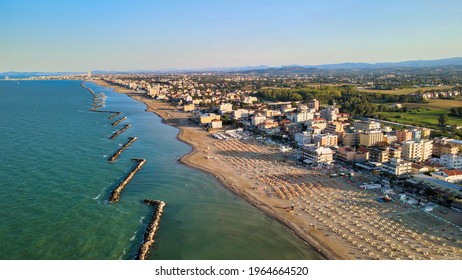 Aerial view of Torre Pedrera Beach from drone in summer season, Rimini, Italy.