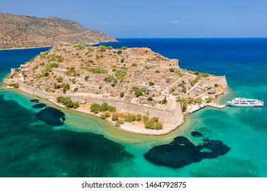Aerial view of tourist boats on the ruins of the fortress and former leper colony island of Spingalonga (Elounda, Crete, Greece)