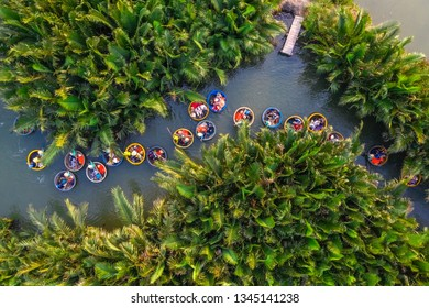 Aerial view, tourists from China, Korea, America and Russia are relax and experiencing a basket boat tour at the coconut water ( mangrove palm ) forest in Cam Thanh village, Hoi An, Quang Nam, Vietnam