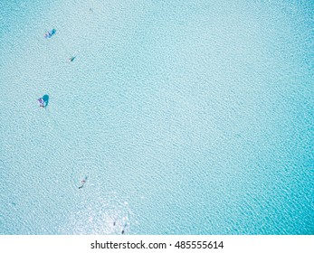 Aerial view of tourists swimming in beautiful clear sea water