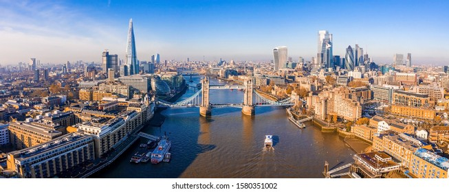 Aerial view of the Tower Bridge in London. One of London's most famous bridges and must-see landmarks in London. Beautiful panorama of London Tower Bridge. - Shutterstock ID 1580351002