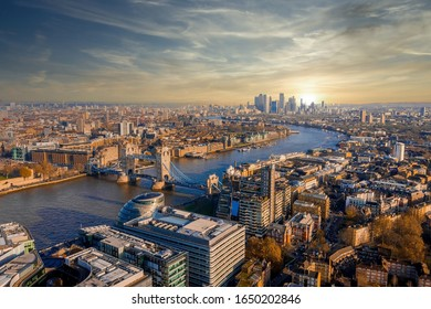 Aerial view of the tower Bridge in London, the UK. Sunset over London with beautiful clouds. Drawbridge opening. The symbol of Great Britain.