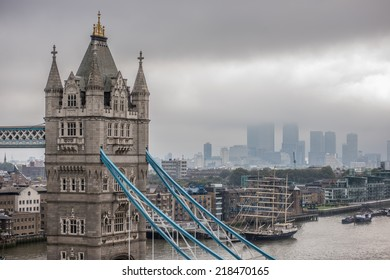 Aerial view of Tower Bridge and the skyscrapers of the financial district of Canary Wharf surrounded by low clouds on an overcast and foggy day
