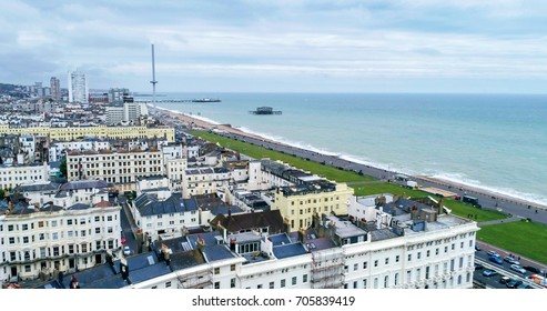 Aerial view of the town of Brighton and Hove towards the beach and the two piers