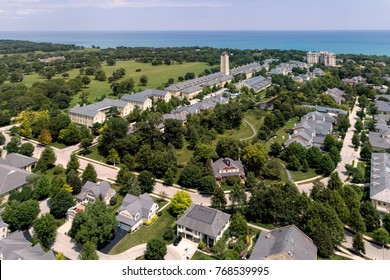 Aerial view of the town of Ft. Sheridan, Illinois with condos and homes in a park-like setting along the shores of Lake Michigan.