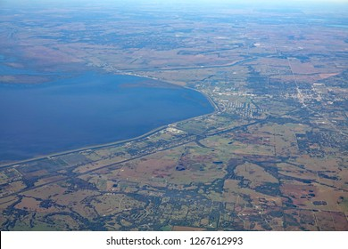 Aerial view of the town of Okeechobee, on the north shore of Lake Okeechobee, with the Kissimmee River flowing into the lake, causing algae pollution.