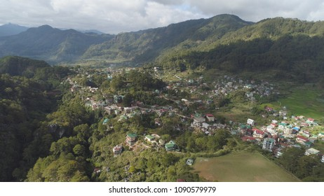 Aerial view town of Sagada, located in the mountainous province of Philippines. City in the valley among the mountains covered with forest. Sagada-Cordllera region-Luzon island.