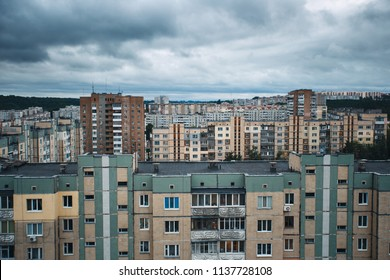 Aerial view of town with socialist soviet panel building (plattenbau) at cloudy day. Buildings were built in the Soviet Union (now Ukraine). The architecture looks like most post-soviet commuter towns