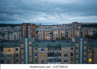 Aerial view of town with socialist soviet panel building (plattenbau) at evening. Buildings were built in the Soviet Union (now Ukraine). The architecture looks like most post-soviet commuter towns.