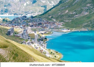 Aerial view of the town of Tignes (France) and its lake Lac de Tignes