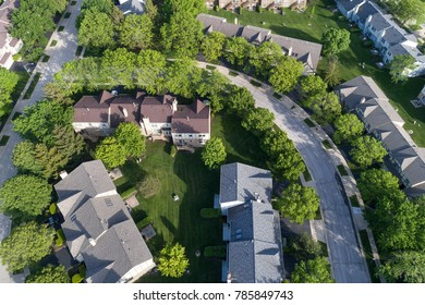 Aerial view of a townhouse complex in a circular Chicago suburban neighborhood in summer. Hoffman Estates, IL. USA