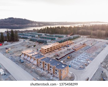 An aerial view of a townhouse complex and a new development under construction nearby in North Vancouver, BC.