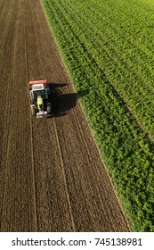 aerial view of the tractor on the harvest field in Poland