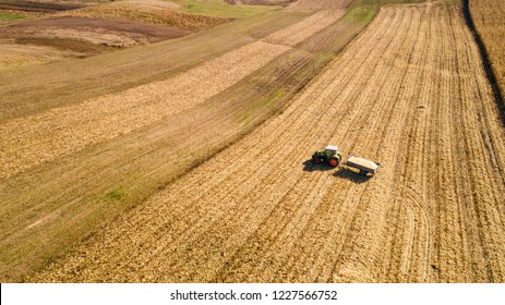 Aerial view of tractor working in the fields. Countryside agriculture working details