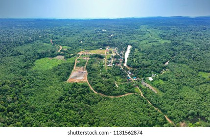 Aerial view of traditional Dayak Merabu village in heart of jungle near the river with mountains in the back in the North Kalimantan (Borneo), Indonesia