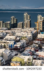Aerial view of traditional urban developement in Reykjavik, Iceland in winter with snow covered roofs viewed from above.