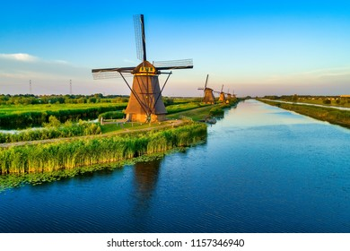 Aerial view of traditional windmills in Kinderdijk, The Netherlands. This system of 19 windmills was built around 1740 and is a UNESCO heritage site.