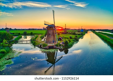 Aerial view of traditional windmills at sunset in Kinderdijk, The Netherlands. This system of 19 windmills was built around 1740 and is a UNESCO heritage site.