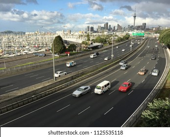 Aerial view of traffic against Auckland city downtown skyline, New Zealand
