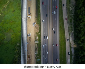 Aerial view of traffic on a major Texas freeway.