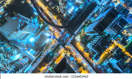 Aerial view traffic road at night in downtown for transportation or traffic background.